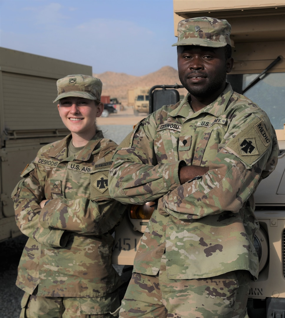 Spc. Stephen Ezenwosu and Pfc. Isadora Desrochers, medics with Headquarter Company, 1st Battalion 279th Infantry Regiment, 45th Infantry Brigade Combat Team, train at the National Training Center near Fort Irwin, CA, July 2021. Ezenwosu and Desrochers joined the OKNG on their path to become U.S. citizens. (Oklahoma Army National Guard photo by Spc. Caleb Stone)