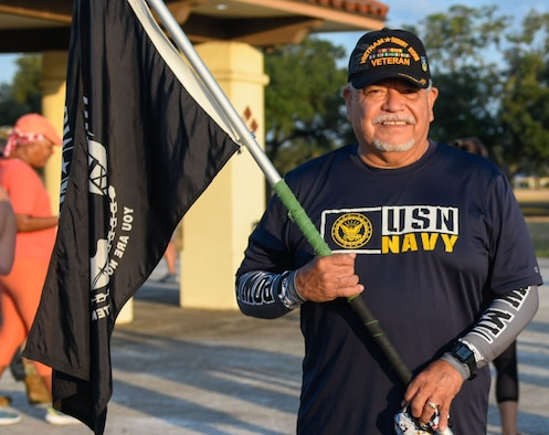 Joint Base San Antonio community members participate in a 5-Kilometer run commemorating Prisoners of War and Missing in Action Recognition Day