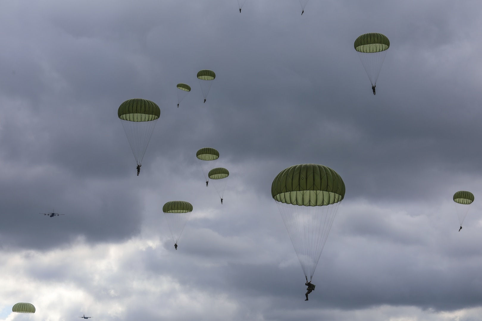 Participants from 12 NATO allied forces and local citizens paid homage to the 77th Anniversary of Operation Market Garden by gathering at a series of drop zones across the Netherlands and Belgium to observe one thousand Soldiers parachuting from U.S Air Force C-130s and allied force aircrafts during Falcon Leap.