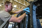 Army Sgt. Scott M. Peterson with the 1-150th Assault Helicopter Battalion, New Jersey Army National Guard, tightens a bleed plug on a main landing gear strut of a UH-60L Black Hawk helicopter at Joint Base McGuire-Dix-Lakehurst, N.J., Sept. 5, 2018. The Defense Logistics Agency manages industrial hardware items such as bolts and seals used to maintain aircraft and vehicles.