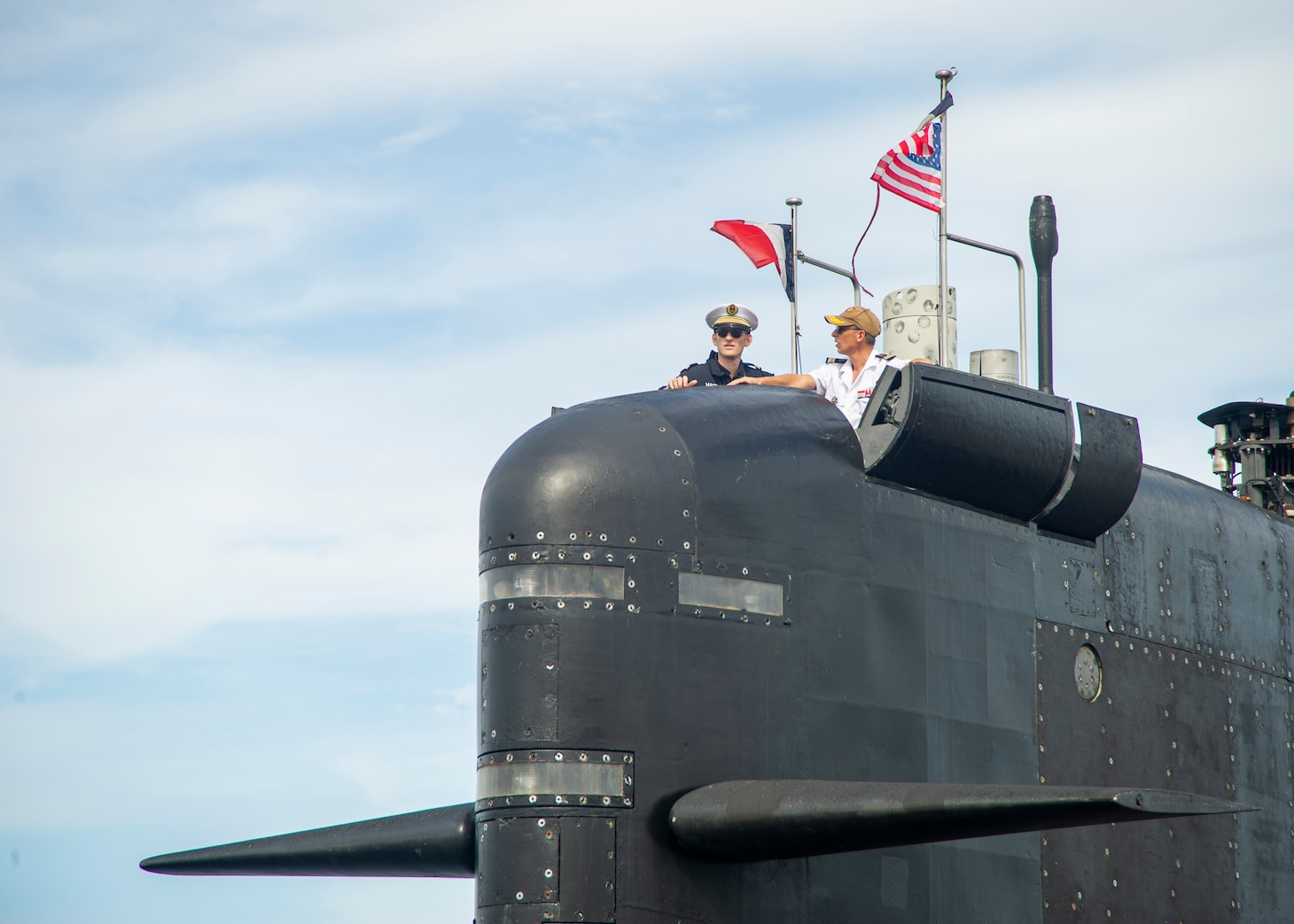 Leadership aboard the French submarine FNS Améthyste (S605) man the boat's conning tower as it moors pier side at Naval Station Norfolk, Sept. 16, 2021.