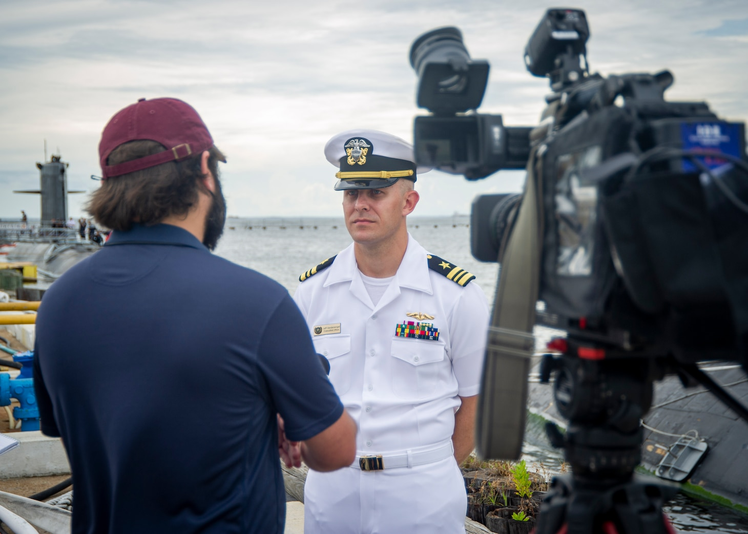 Lt. Cmdr. Jeff Vandenengel, executive officer of the Virginia-class fast-attack submarine USS John Warner (SSN 785), conducts a media interview after the arrival of the French submarine FNS Améthyste (S605) at Naval Station Norfolk, Sept. 16, 2021