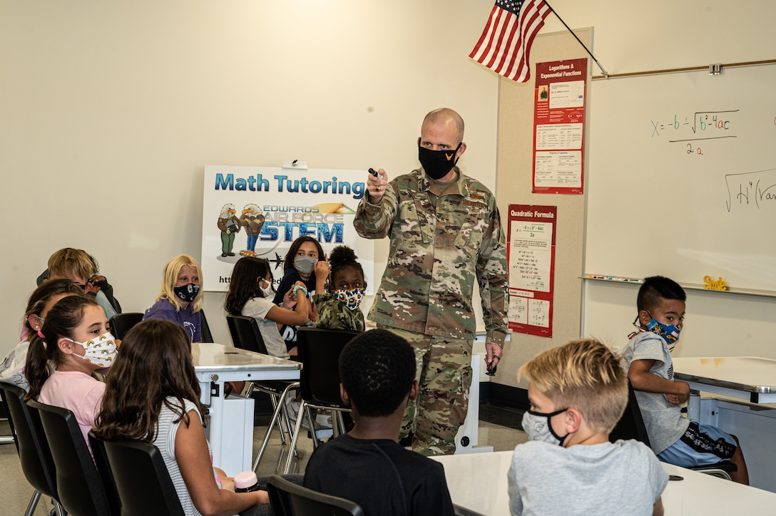 Brig. Gen. Matthew Higer, 412th Test Wing Commander, fields questions from 5th graders at Irving L. Branch Elementary School at the kick-off of the Math Tutoring Club on Edwards Air Force Base, California, Sept. 13. (Air Force photo by Katherine Franco)