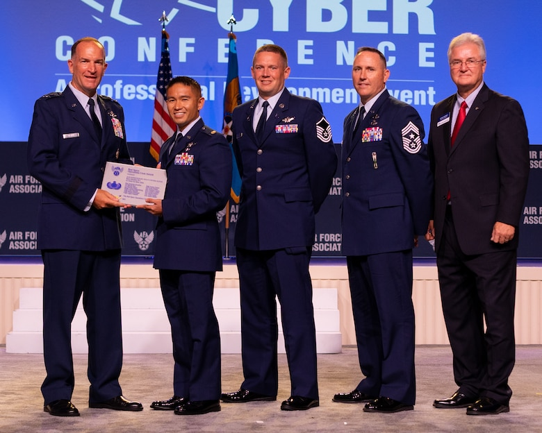 Maj. Gen. John Healy, deputy chief of Air Force Reserve, presents the Best Space Operations Crew Award to the 16th Expeditionary Space Control Flight Bravo, rotation 20-2, at the Air, Space & Cyber Conference at National Harbor, Maryland.