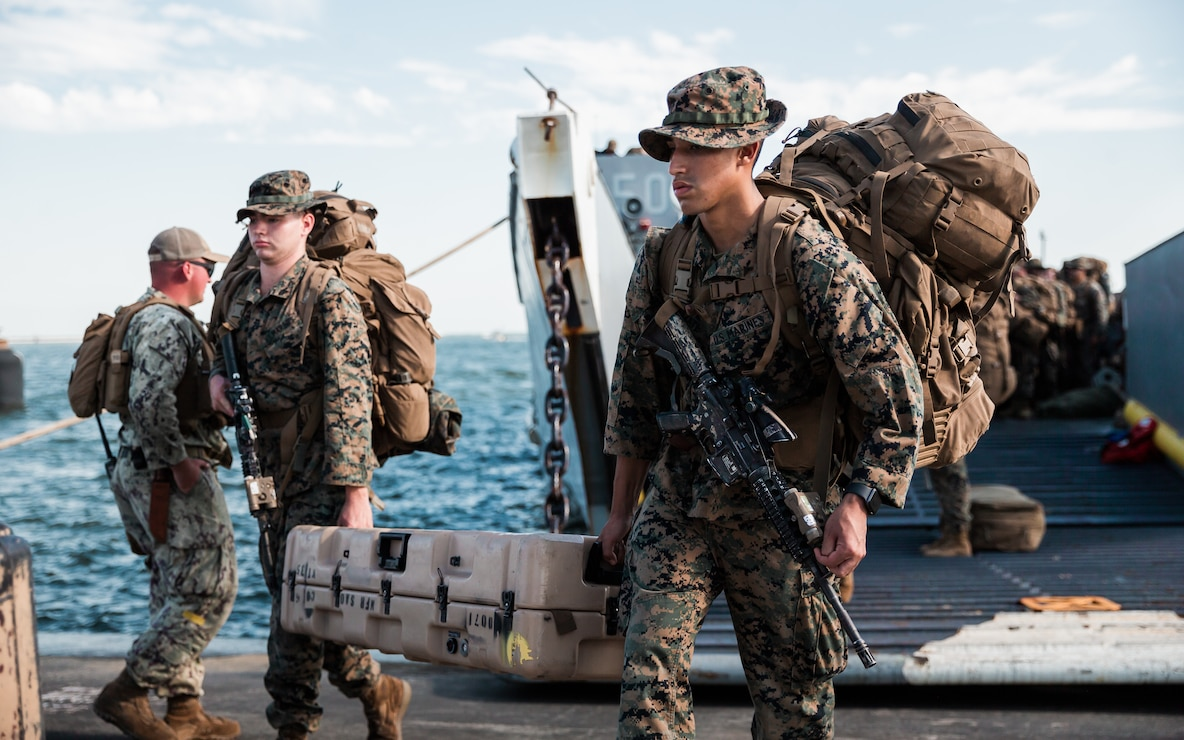U.S. Marines with 1st Battalion, 6th Marine Regiment (1/6), 2d Marine Division, disembark a U.S. Navy landing craft utility with Assault Craft Unit Two in Morehead City, N.C., Sept. 6, 2021. Marines with 1/6 deployed in support of Joint Task Force-Haiti for a humanitarian assistance disaster relief mission. (U.S. Marine Corps photo by Cpl. Patrick King)