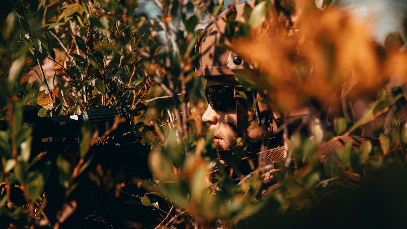 U.S. Marine Corps Cpl. Matthew Franchebois, a reconnaissance Marine with 3rd Platoon, Force Reconnaissance (Recon) Company, 2d Recon Battalion, 2d Marine Division, posts flank security during a live-fire ambush drill on Camp Lejeune, N.C., Sept. 14, 2021. Force Recon Company conducted several different live-fire ranges designed to increase effectiveness and lethality within the teams in various scenarios. (U.S. Marine Corps photo by Lance Cpl. Jacqueline C. Arre)