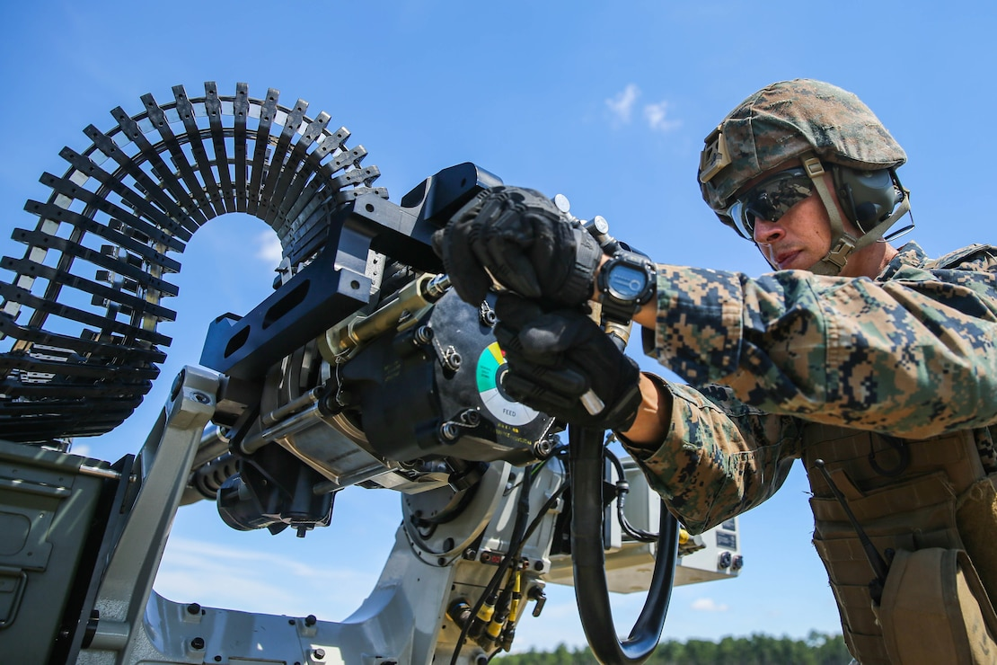 U.S. Marine Corps 1st Lt. Kolby Wickman, an assault amphibious vehicle officer with 2d Assault Amphibian Battalion, 2d Marine Division (MARDIV), prepares to reload an XM914 System during a demonstration at Camp Lejeune, N.C., Sept. 10, 2021. Marines from 2d MARDIV partnered with the Office of Naval Research (ONR) to demonstrate a remote live-fire using a 30mm system attached to a Joint Light Tactical Vehicle. ONR works with the Marine Corps and industry partners to research and evaluate capabilities that may ultimately support the needs of the Marine Corps. (U.S. Marine Corps photo by Lance Cpl. Reine Whitaker)