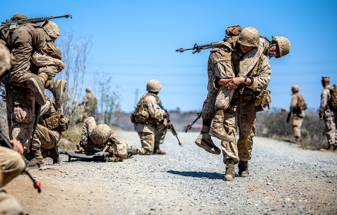 U.S. Marine recruits with Mike Company, 3rd Recruit Training Battalion, conduct a mass casualty scenario during the crucible at Marine Corps Base Camp Pendleton, Calif., Sept. 14, 2021.