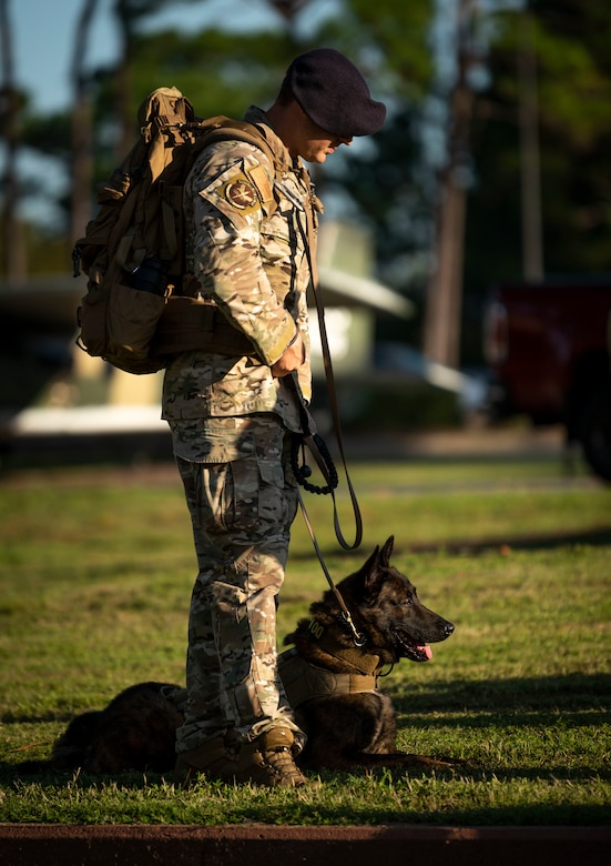 A 1st Special Operations Security Forces Squadron military working dog handler waits for a 9/11 Memorial Ruck Ceremony to begin