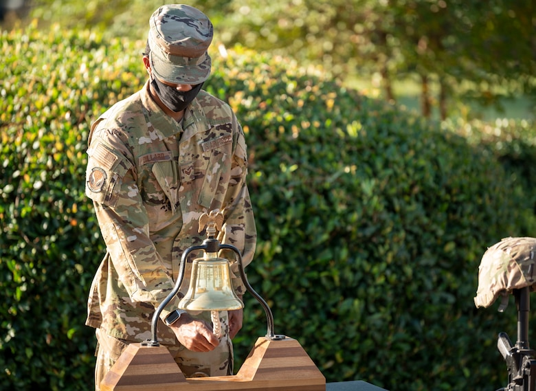 U.S. Air Force Senior Airman Marcus Dillard, a 1st Special Operations Civil Engineer Squadron firefighter, performs the bell ringing during a 9/11 Memorial Ruck Ceremony