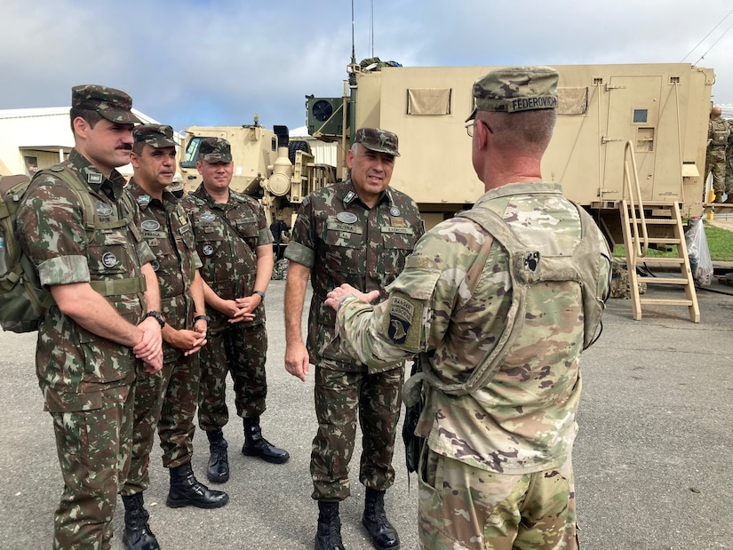 Lt. Gen. Gustavo Dutra, Brazil Army Chief of Land Force Preparation, receives a brief from Col. Mark Federovich, commander, 3rd Infantry Brigade Combat Team, 101st Airborne Division (Air Assault) on North Fort Polk ahead of the Rakkasans' air assault into the box. The Brazilian Army delegation visited the Joint Readiness Training Center at Fort Polk, La., Sept. 16-19 to get an overview on training in preparation for bilateral training between the U.S. and Brazilian armies. These partnerships are vital to our security and prosperity in the hemisphere and to our collective ability to meet complex global threats and challenges.