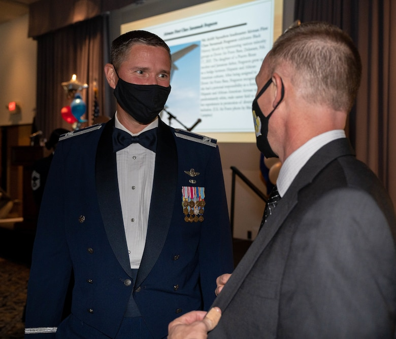 Col. Shanon Anderson, 436th Airlift Wing vice commander, speaks with Craig Lindstrom, 436th AW director of staff, during the 2021 Air Force Ball at Dover Air Force Base, Delaware, Sept. 18, 2021. The Air Force Ball is an annual event held to celebrate the Air Force's birthday. (U.S. Air Force photo by Senior Airman Faith Schaefer)