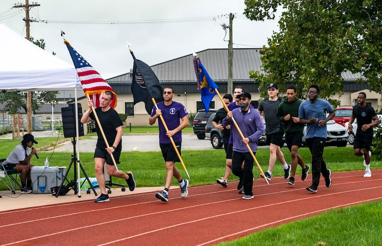 Members of the 436th Communications Squadron participate in the 2021 POW/MIA memorial run on Dover Air Force Base, Delaware, Sept. 17, 2021. Units from across Dover AFB ran in 30-minute increments for 12 hours leading to a retreat ceremony commemorating National POW/MIA Recognition Day. (U.S. Air Force photo by Senior Airman Stephani Barge)