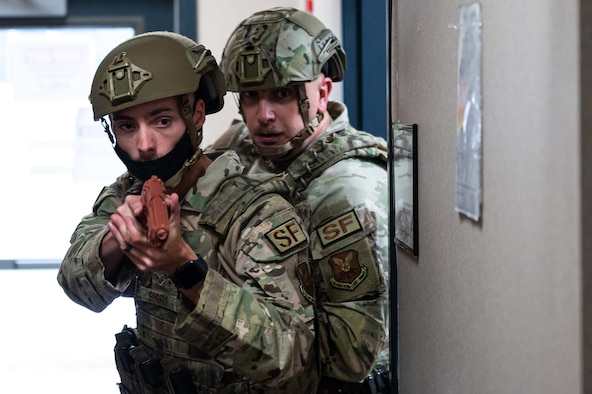 Senior Airman Zachary Burris, 2nd Security Forces Squadron installation patrolman, left, and Tech. Sgt. Jacob Udell, 2nd SFS flight sergeant, clear a building of threats during an active shooter exercise at Barksdale Air Force Base, Louisiana, Sept. 16, 2021. The 2nd SFS Airmen are the first to respond to an active shooter and they're tasked with neutralizing the threat and protecting base personnel. (U.S. Air Force photo by Airman 1st Class Jonathan E. Ramos)