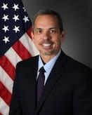 Official portrait of civilian male in suit.