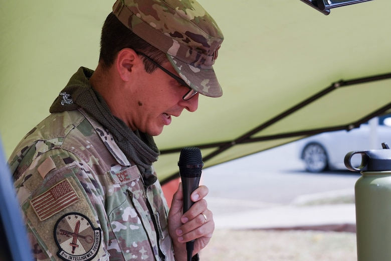 Capt. Brian Preece, 8th Intelligence Squadron flight commander, reads a list of all Prisoner of War and Missing in Action names during a 24-hour run at Joint Base Pearl Harbor-Hickam, Hawaii, Sept. 16, 2021. During the run, the POW/MIA flag will stay in motion for 24-hours by volunteers running with the flag to commemorate and symbolize the unwavering pursuit to recover all service members past and present. (U.S. Air Force photo by Airman 1st Class Makensie Cooper)
