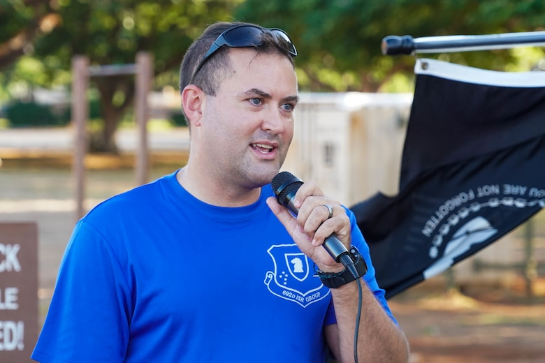 Master Sgt. Christopher Ewers, Air Force Sergeants Association president, kicks off the 24-hour, Prisoners of War and Missing in Action run at Joint Base Pearl Harbor-Hickam, Hawaii, Sept. 16, 2021. During the run, the POW/MIA flag will stay in motion for 24 hours by volunteers running with the flag to commemorate and symbolize the unwavering pursuit to recover all service members past and present. (U.S. Air Force photo by Airman 1st Class Makensie Cooper)