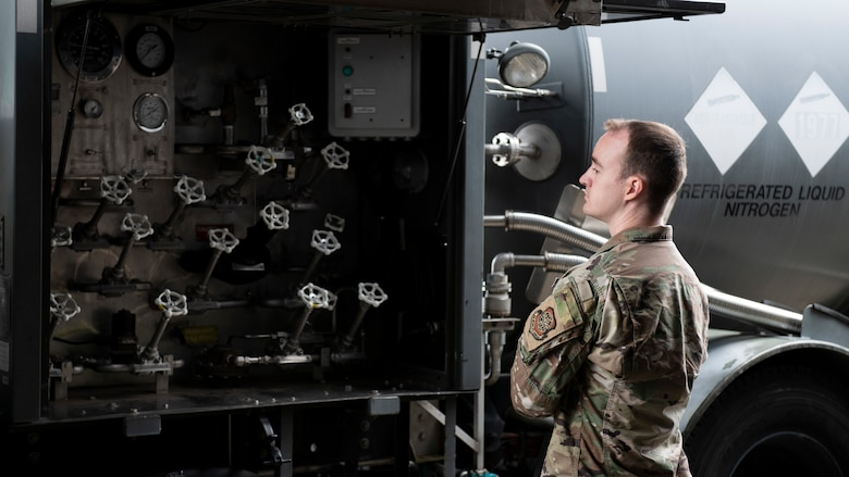 An Airman looks over the many gas valve controls of a nitrogen gas truck