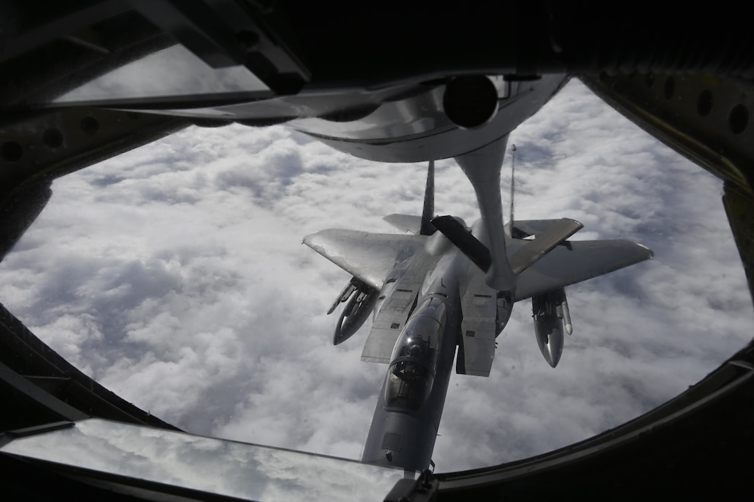 A U.S. Air Force KC-135 Stratotanker aircraft assigned to the 100th Air Refueling Wing, Royal Air Force Mildenhall, England, refuels a F-15C Eagle aircraft assigned to the 48th Fighter Wing, RAF Lakenheath, England, during exercise High Life over the North Sea, Sept. 15, 2021. The complexity of the European continent and the tyranny of proximity makes operating with allies and partners throughout Europe an imperative. (U.S. Air Force photo by Senior Airman Joseph Barron)