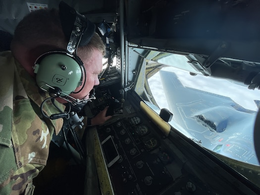 U.S. Air Force Master Sgt. Dustin Clark, Headquarters U.S. Air Forces in Europe standards and evaluations command air refueling evaluator, refuels a B-2 Spirit aircraft assigned to the 509th Bomb Wing, Whiteman Air Force Base, Missouri, over Europe during a bomber task force mission Sept. 8, 2021. U.S. bomber aircraft contribute to European regional security with the support of U.S. Air Forces in Europe and Air Forces Africa's only permanent air refueling wing. (U.S. Air Force photo by Senior Airman Joseph Barron)