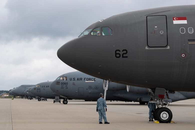 Republic of Singapore Air Force personnel perform pre-flight checks on a RSAF A330 Multi-Role Tanker Transport aircraft.
