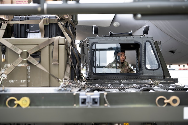U.S. Air Force Staff Sgt. Jordan Gilchrist, 726th Air Mobility Squadron aircraft services supervisor, uses a Tunner 60K aircraft cargo loader to load cargo onto a Republic of Singapore Air Force A330 Multi-Role Tanker Transport aircraft on Spangdahlem Air Base, Germany, Aug. 30, 2021.