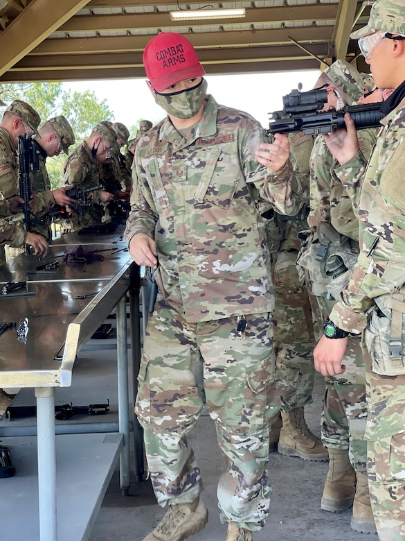 CATM instructor inspects trainees' weapons