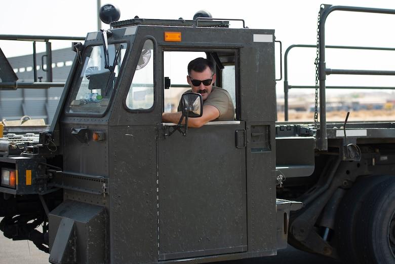 A photo of an Airman driving a loader