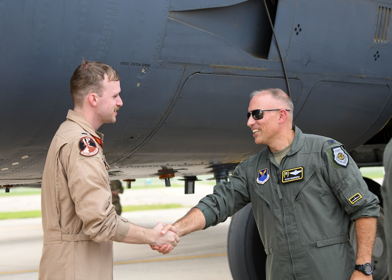 The 5th Bomb Wing vice commander greets a pilot as he returns from deployment