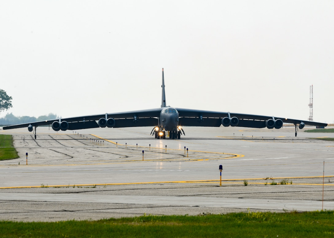 A B-52 taxis on the runway as it returns from Qatar from deployment