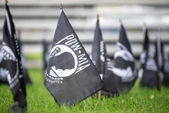 Rows of POW/MIA flags are planted in formation for a retreat ceremony commemorating National POW/MIA Recognition Day on Dover Air Force Base, Delaware, Sept. 17, 2021. The flags represented the 82,000 U.S. military service members still missing in action. (U.S. Air Force photo by Mauricio Campino)
