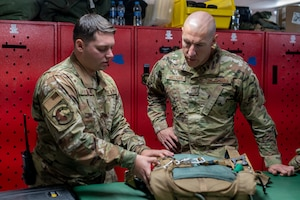 U.S. Air Force Chief Master Sgt. Sean Milligan, 332nd Air Expeditionary Wing command chief, meets with Airmen from the 26th Expeditionary Rescue Squadron Sept. 18, 2021, at an undisclosed location somewhere in Southwest Asia.
