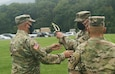 Soldiers with the 213th Regional Support Group gathered at Strickler Field on Fort Indiantown Gap Sept. 17 to witness the transfer responsibility from Command Sgt. Maj. Andrew Campbell to Command Sgt. Maj. Marc Weiss in a traditional ceremony. To symbolize the transfer of responsibility, a ceremonial sword was passed from Campbell, to 213th RSG commander Col. Angelo Catalano, who then passed it to Weiss. (U.S. Army National Guard photo by Staff Sgt. Zane Craig)