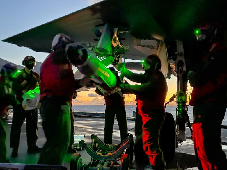 US Marines with Marine Fighter Attack Squadron 211 load a Guided Bomb Unit 49 onto an F-35B Lightning II Joint Strike Fighter in the Western Pacific Ocean on September 12th, 2021. The GBU-49 is a laser and GPS-guided bomb effective across various conditions and against many types of moving or stationary target. VMFA-211, deployed aboard HMS Queen Elizabeth as part of the United Kingdom's Carrier Strike Group 21, became the first fleet squadron to employ the GBU-49 in a training exercise.