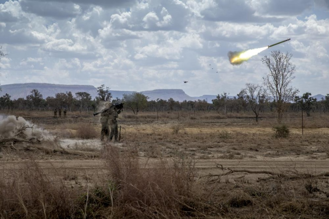 U.S. Marine Corps Lance Cpl. Andrew Morabito, right, a gunner, fires an FIM-92 Stinger missile at a drone with assistant gunner, Sgt. Jason Jones, a squad leader, both with Alpha Battery, 2nd Low Altitude Air Defense Platoon, Marine Medium Tiltrotor Squadron - 363, MRF-D at Bradshaw Field Training Area, NT, Australia, Sep. 3, 2021. The range consisted of Marines and Australian Army soldiers utilizing their respective missile systems to take down notional enemy surveillance drones. The training hones the Marines' capabilities as a skilled expeditionary fighting force that is capable of responding to a potential crisis or contingency.
