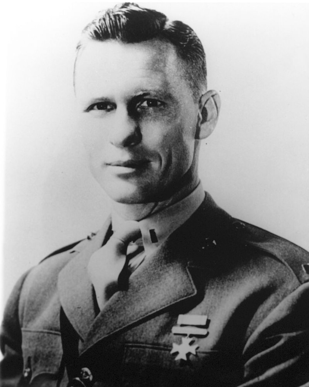 Man in uniform poses for photo.
