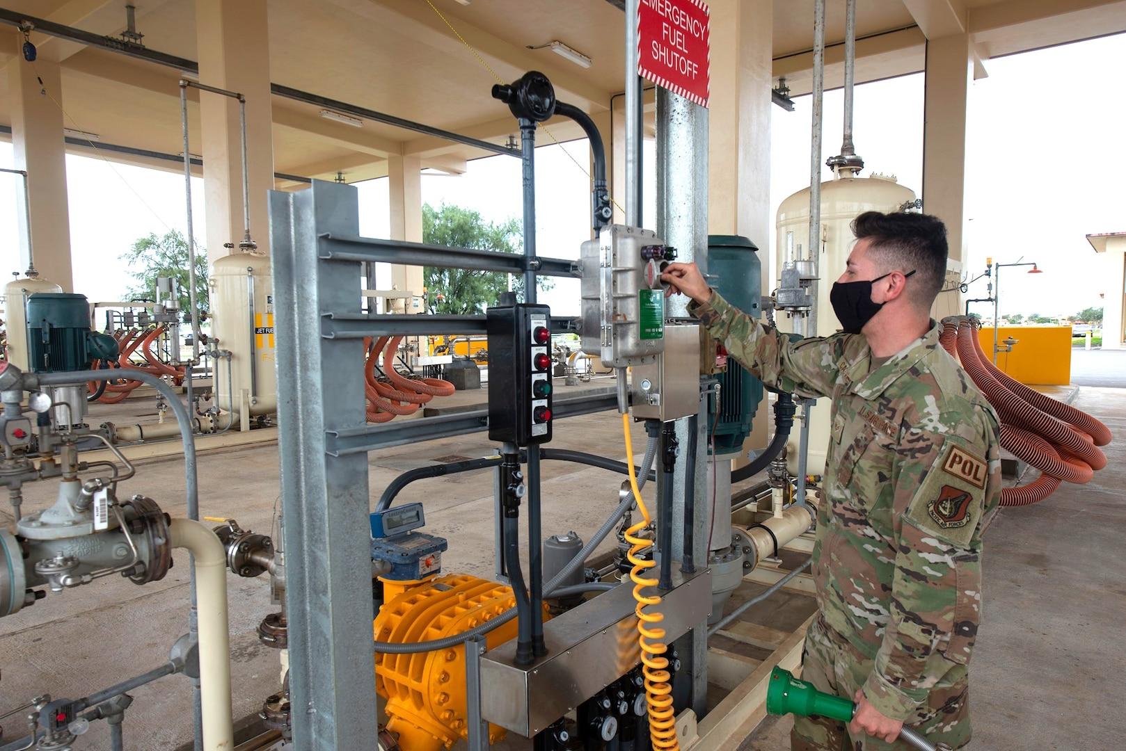a military member tests a fuel pump