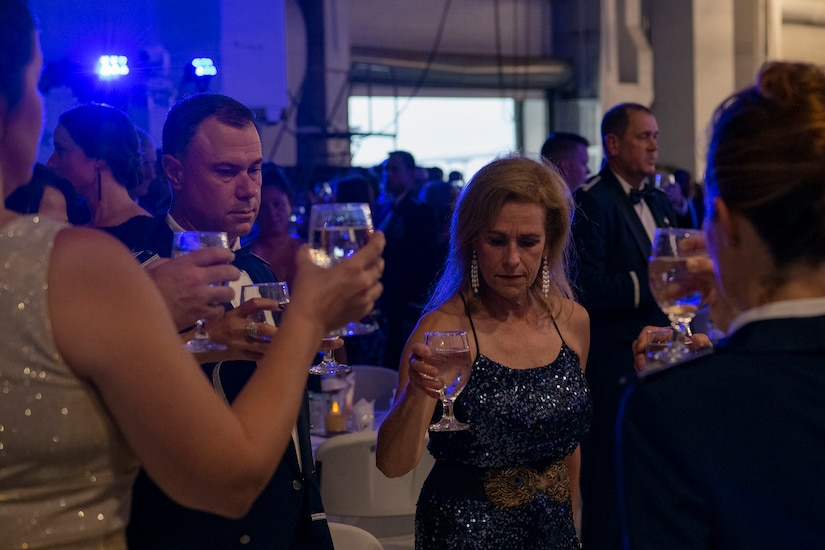 Airmen and their families present a silent toast, during the Air Force Ball aboard the USS YORKTOWN at Patriot's Point, Mount Pleasant, South Carolina, Sept. 17, 2021. Attendees present a silent toast in honor of America's POW/MIA and to the success of the efforts to account for them.