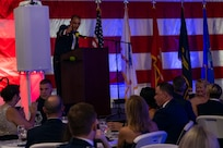 U.S. Air Force Col. Marc Greene, the 628th Air Base Wing and Joint Base Charleston commander, delivers opening remarks during the Air Force Ball at Patriot's Point, Mount Pleasant, South Carolina, Sept. 17, 2021. Service members attended the ball aboard the USS YORKTOWN, tenth aircraft carrier to serve in the U.S. Navy until its decommissioning in 1970.