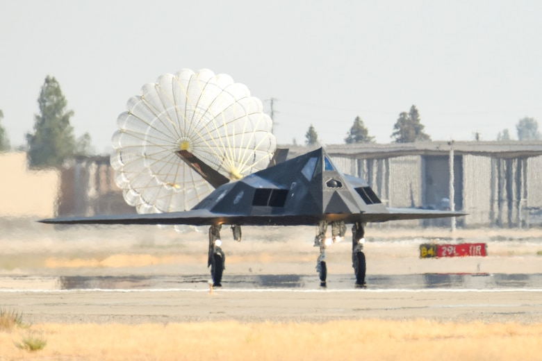 F-117 Nighthawks are accompanied by F-15 Eagles on the flightline of the 144th Fighter Wing located at the Fresno Air National Guard Base, Calif. Sept. 15, 2021.