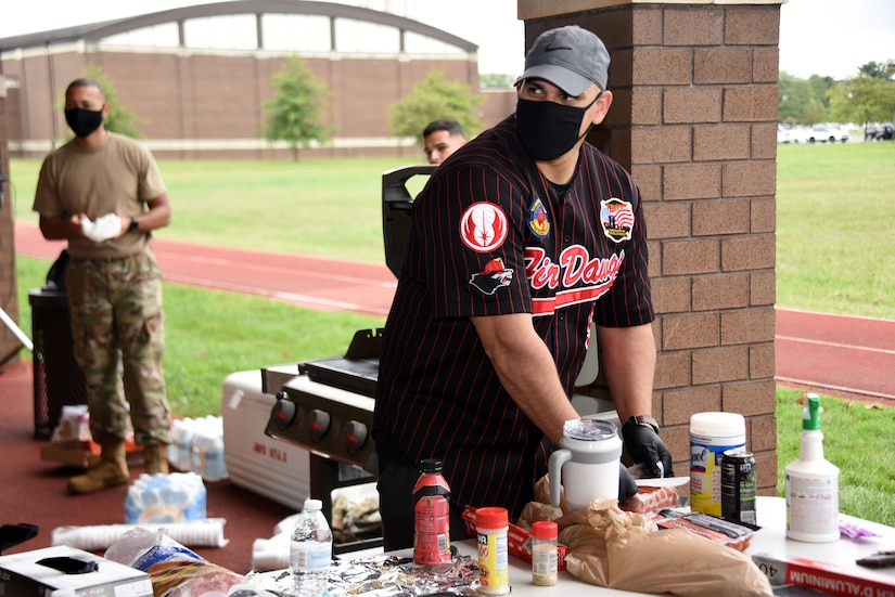 Airman sets up food and refreshments during the POW/MIA run or walk event.