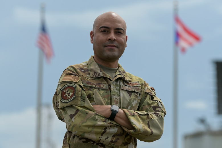 U.S. Air Force Master Sgt. Dennis Martinez, an airborne systems operator with the 156th Operations Group, Host Nation Rider program, poses for a portrait, Sept. 15, 2021 at Punta Salinas Air Guard Station, Toa Baja, Puerto Rico Air National Guard. Martinez was selected as the September spotlight for his merits and performance as an airborne systems operator. (U.S. Air National Guard photo by Tech. Sgt. Rafael D. Rosa)