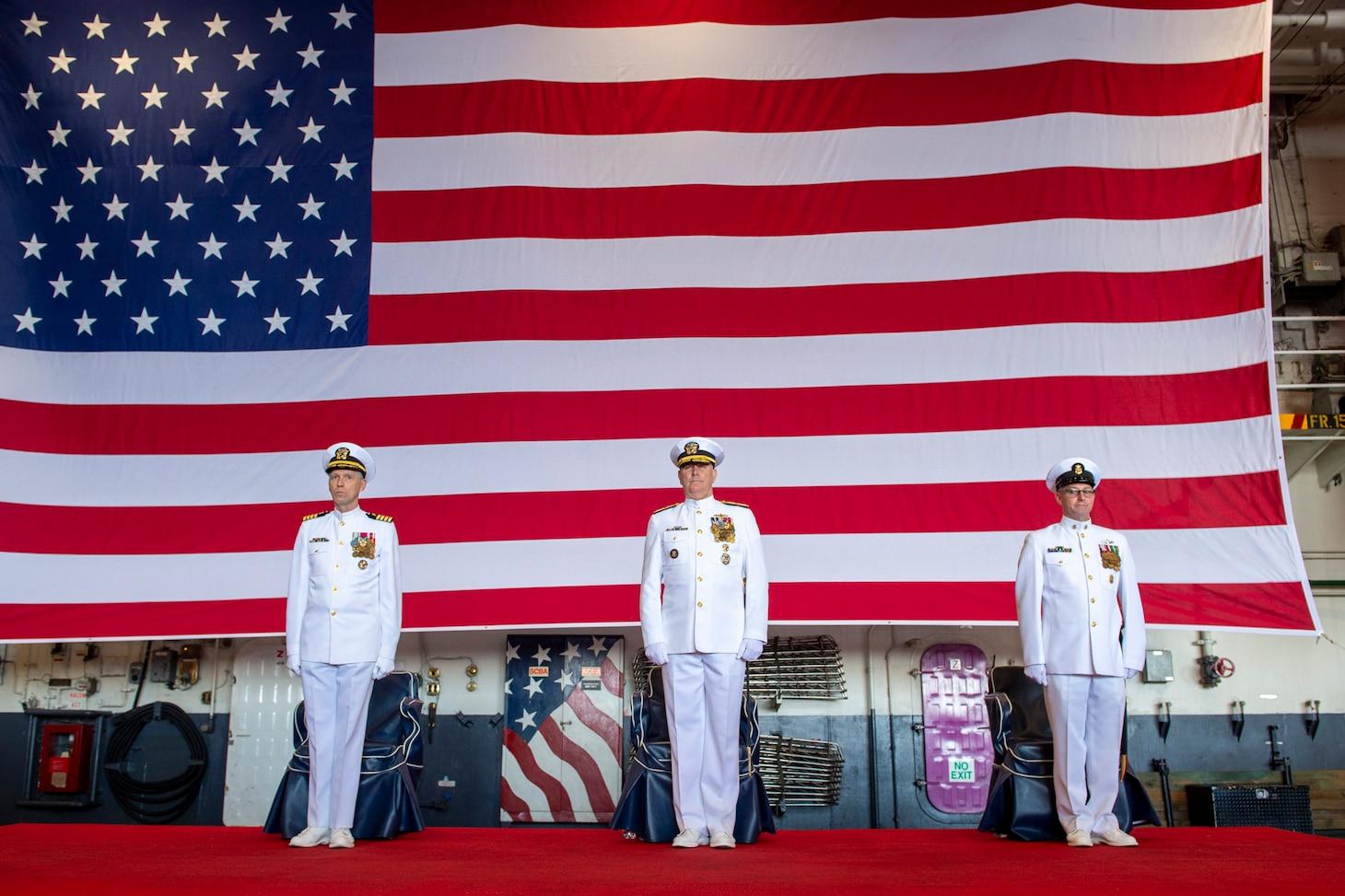 Adm. Christopher W. Grady, commander, U.S. Fleet Forces Command, center, presides over the retirement ceremony of Fleet Master Chief Rick O'Rawe on board USS Harry S. Truman (CVN 75) in Norfolk, Va., September 2, 2021.