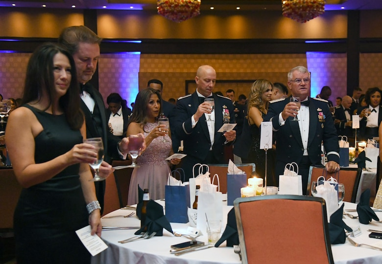 Keesler personnel participate in a toasting ceremony during the Keesler Air Force Ball inside the Golden Nugget Casino, Biloxi, Mississippi, Sept. 18, 2021. The event, which celebrated the Air Force�s 74th birthday, also included a cake cutting ceremony. (U.S. Air Force photo by Kemberly Groue)