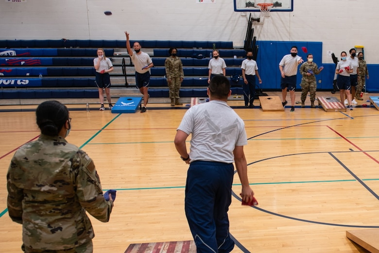 Members of the 932nd Medical Group participate in the corn hole activity during their annual sexual assault prevention and response/suicide prevention training, Scott Air Force Base, Illinois, Sept. 12, 2021. Each activity reviewed the training material, for example during the fit to fight activity a team of airman would be asked a training question and if answered correctly all other groups would do an exercise. (U.S. Air Force Photo by Staff Sgt. Brooke Spenner)