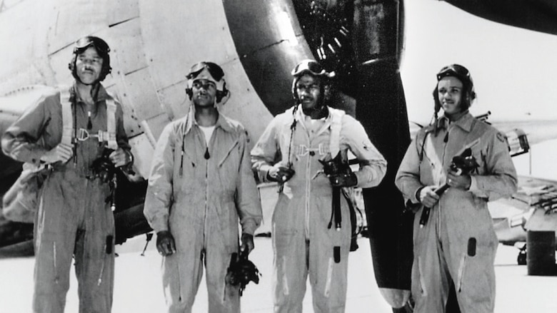 Pilots in front of plane