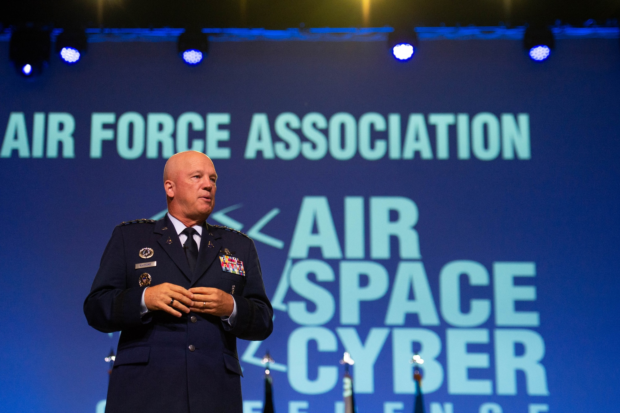 """Chief of Space Operations Gen. John W. """"Jay"""" Raymond gives an update on the U.S. Space Force during the Air Force Association Air, Space and Cyber Conference at National Harbor, Md., Sept. 21, 2021. During his presentation, Raymond previewed the Space Force's Service Dress Prototype and gave insight to the """"Guardian Ideals,"""" which identifies the Space Force's vision for its culture to ensure mission success. (U.S. Air Force photo by Tech. Sgt. Areca T. Wilson)"""