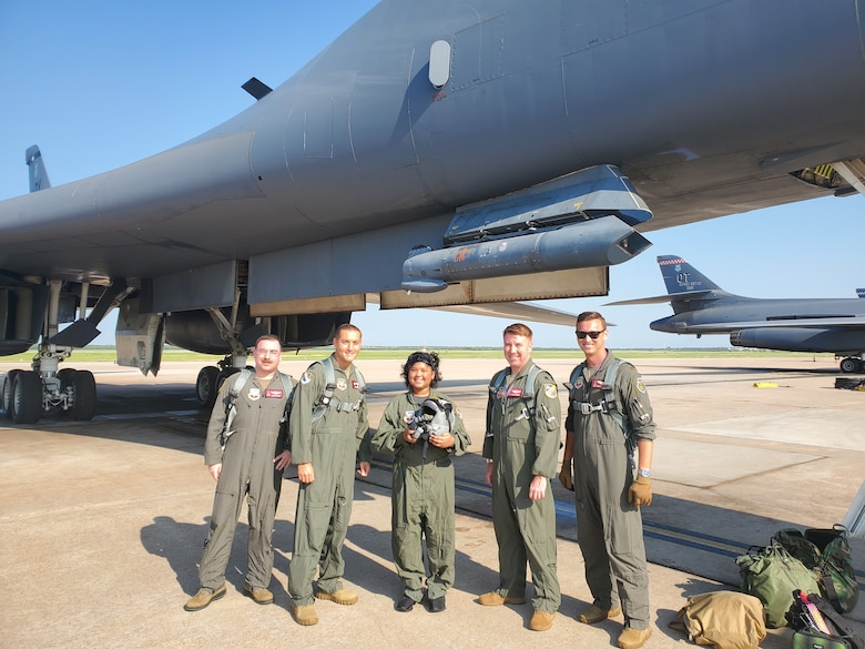 From left to right, Maj. Matthew Sutton, 337th Test and Evaluation Squadron director of test, Col. Jaime Hernandez, 53rd Test Management Group commander, Jayda SoileauGobert, Tech. Sgt. Justin SoileauGobert's daughter, Lt. Col. Thomas Kinnear, 337th TES director of operations, and Maj. Mike Costello, 337th TES chief of weapons and tactics, pose for a group photo at Dyess Air Force Base, Texas, July 7, 2021.