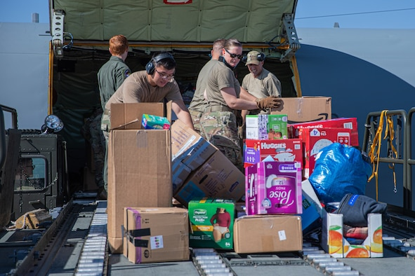 Airmen from Fairchild Air Force Base, Washington, unload donations off a KC-135 Stratotanker in support of Operation Allies Welcome on Holloman Air Force Base, New Mexico, Sept. 17, 2021. The Department of Defense, through U.S. Northern Command, and in support of the Department of State and Department of Homeland Security, is providing transportation, temporary housing, medical screening, and general support for at least 50,000 Afghan evacuees at suitable facilities, in permanent or temporary structures, as quickly as possible. This initiative provides Afghan evacuees essential support at secure locations outside Afghanistan. (U.S. Army photo by Pfc. Anthony Sanchez)