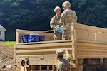 Virginia National Guard Soldiers assigned to the Cedar Bluff-based 1033rd Engineer Company deliver water to residents impacted by flooding Sept. 3, 2021, in Buchanan County, Virginia.